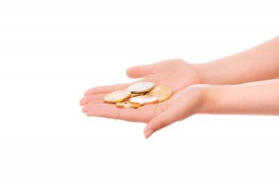 手のひらに乗る金貨
